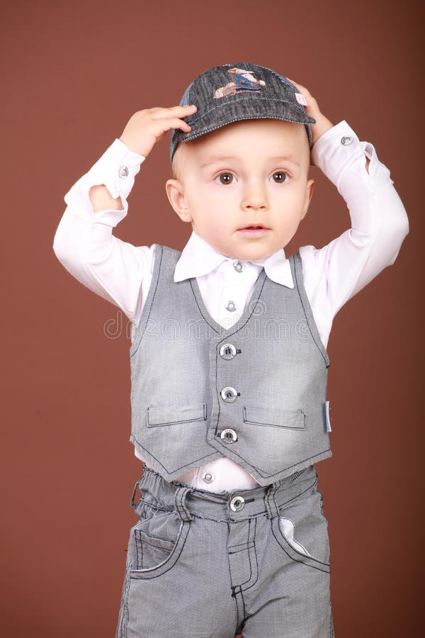 Picture of a little boy who stands in the cap royalty free stock images