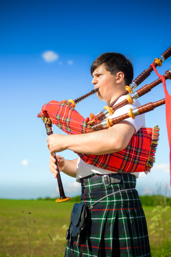 Picture of man enjoying playing pipes in Scottish stock image