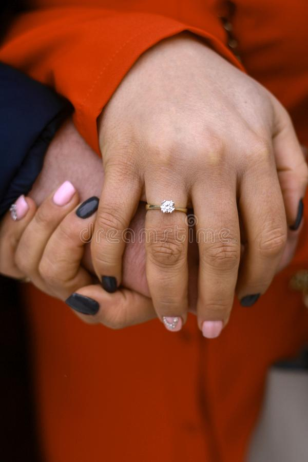 Picture of man and woman hands with wedding ring stock photos