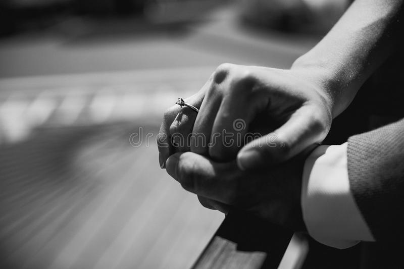 Newly wed couple`s hands with wedding rings royalty free stock images