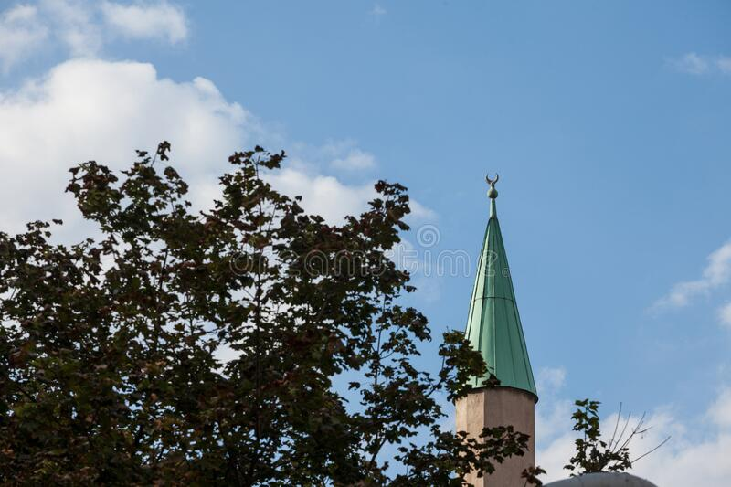Tip of a stone minaret in Belgrade, Serbia, with a typical balkans style, a symbol of islamic religion stock photos