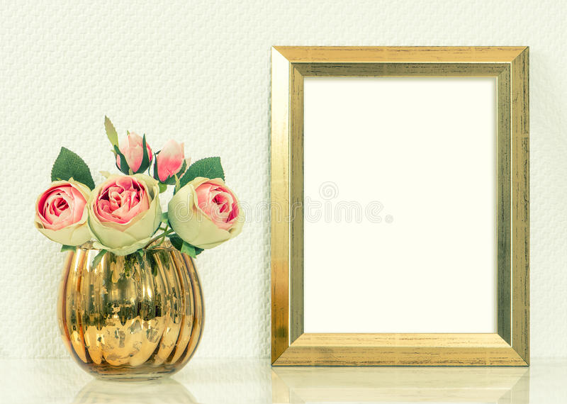 Picture mockup with golden frame and rose flowers. Vintage objec stock image