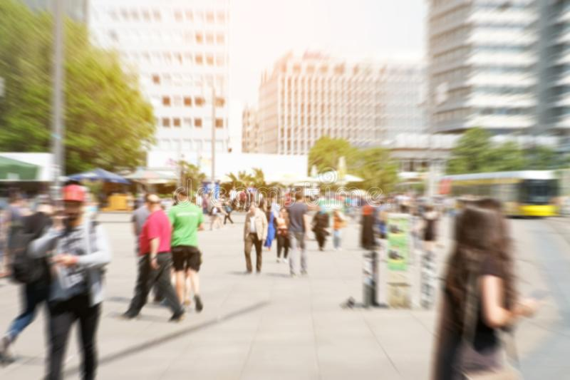 Motion blur of a crowd of people crossing a city street at the stock photo