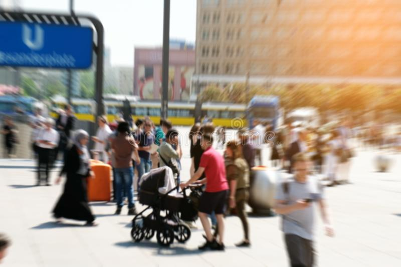 Motion blur of a crowd of people crossing a city street at the royalty free stock photo