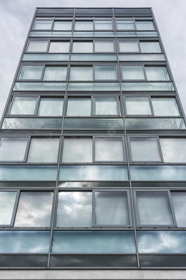 Multiple closed windows on a large office building royalty free stock photography