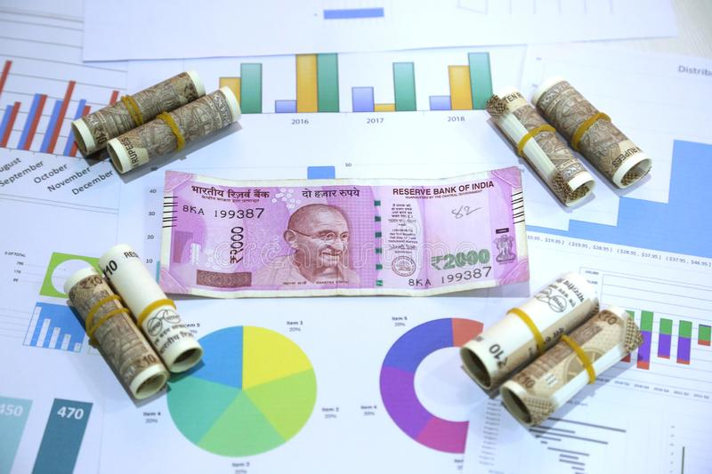 Picture of new Indian 10 rupee and 2000 rupee notes on the chart paper royalty free stock photos