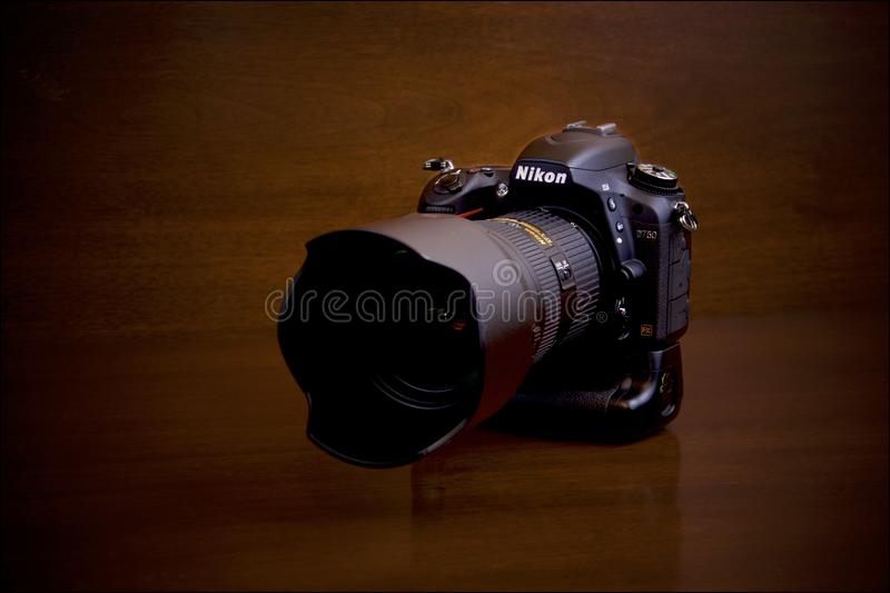 Nikon D750 with MB16. Picture of a Nikon D750 camera with a MB16 battery grip. Shown with a 24-70 mm lens stock photos
