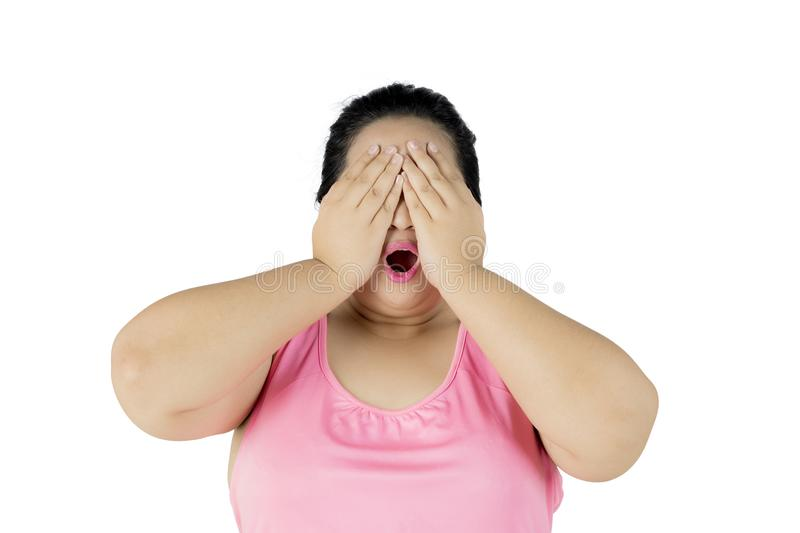 Obese woman looks sad on studio royalty free stock image