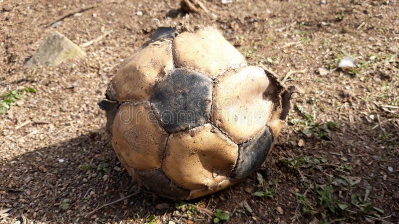 Old football ball. Picture of old football soccer ball royalty free stock photo