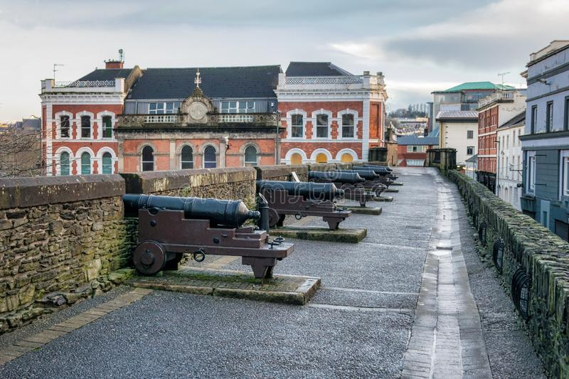 Cannons on the Wall. This is a picture of the old siege cannons on historic Derry Walls in Northern Ireland stock photography