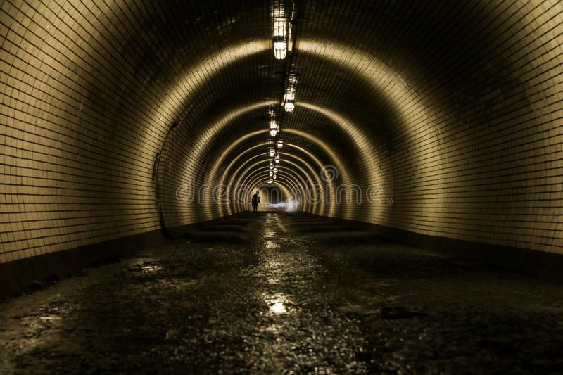 old tunnel for pedestrians with wet floor royalty free stock images