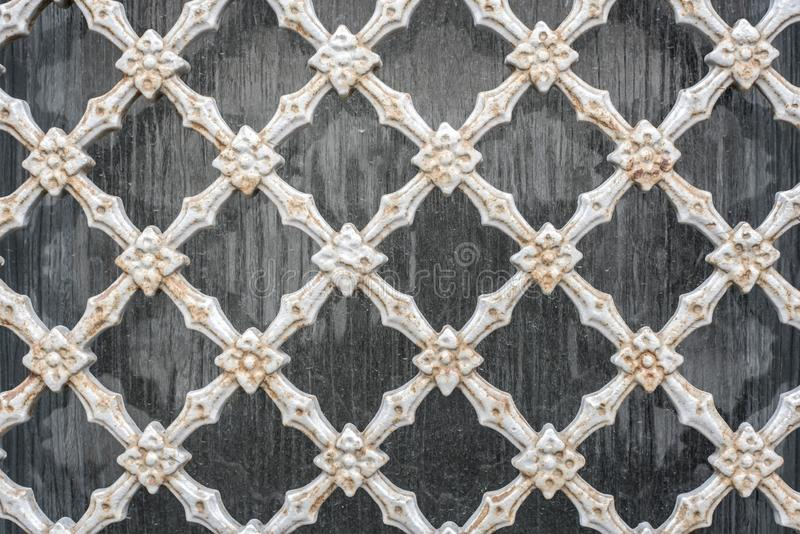 Old vintage steel wire mesh fence wall background stock photo