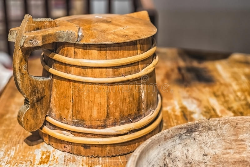 Picture of old vintage wooden mug on the wooden table stock images