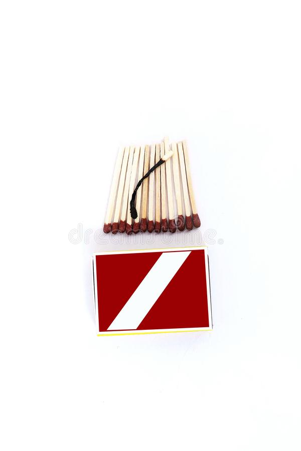 Picture of open matches with one burnt matchstick and box royalty free stock photography