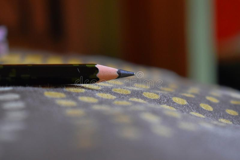 Pointed nib of a pencil. Picture of a p sharp pointed nib of a pencil, focus on a nib royalty free stock photo