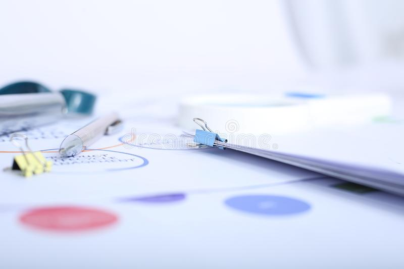 Picture of pen and paper clip on the paper.  stock photography