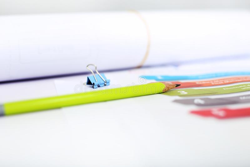 Picture of pencil, roll paper and paper pin on the infographic Templates for Business royalty free stock image
