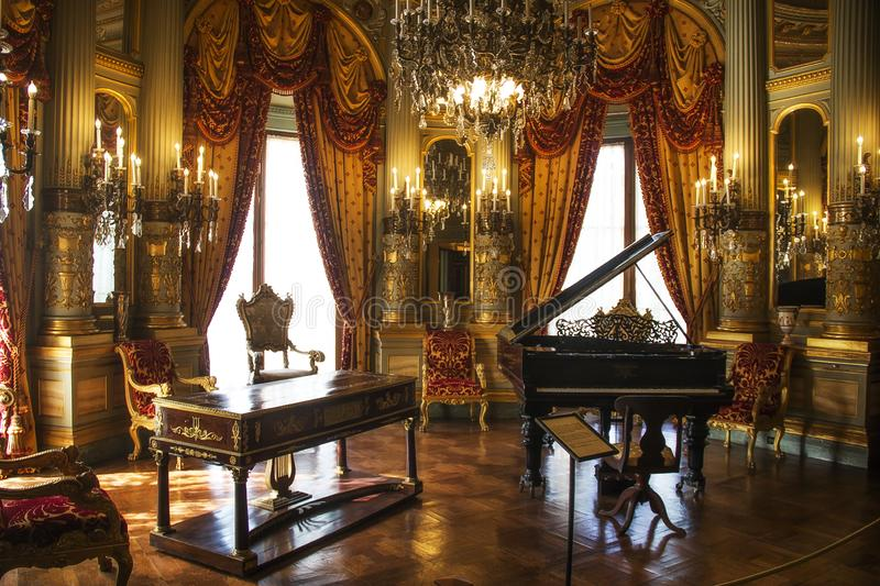 Piano at the Breakers Mansion in Newport Rhode Island. A picture of a piano at the Breakers Mansion in Newport Rhode Island royalty free stock photo