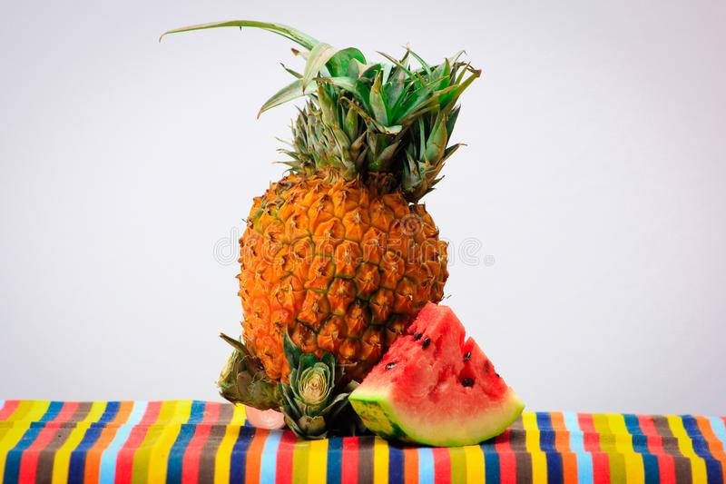Pineapple and Watermelon. Picture of a Pineapple and Watermelon on table royalty free stock images