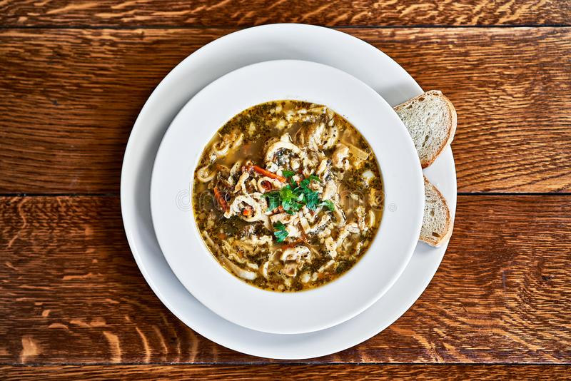 Polish beef tripe soup served on wooden table royalty free stock image