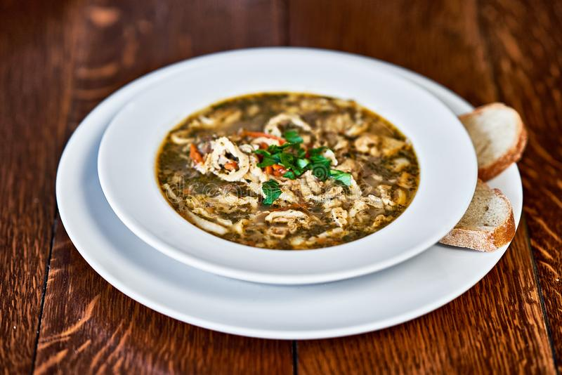 Polish beef tripe soup served on wooden table royalty free stock photos