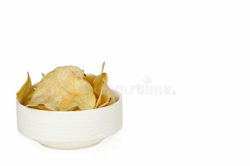 Picture of potato chips in the white bowl for navratri festival. Isolated on the white background stock photography