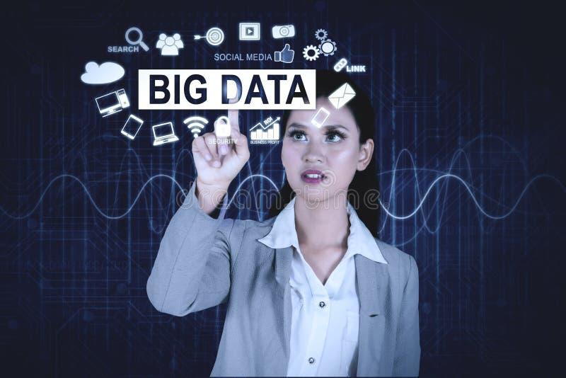 Pretty business woman touches big data text stock photos