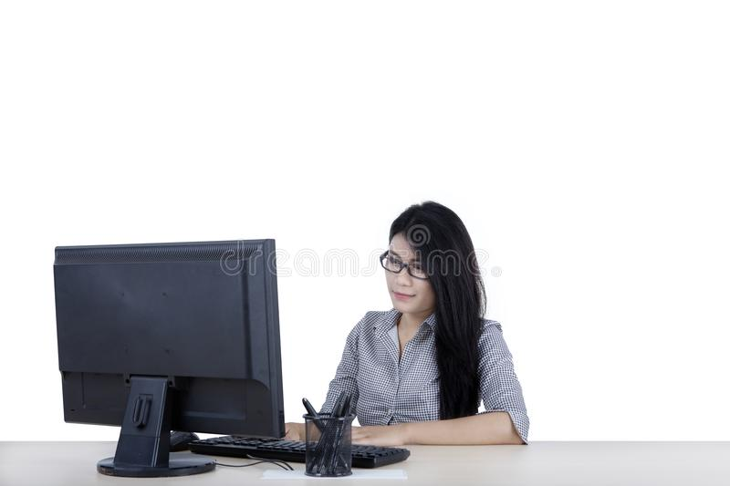 Pretty businesswoman with computer on studio stock image