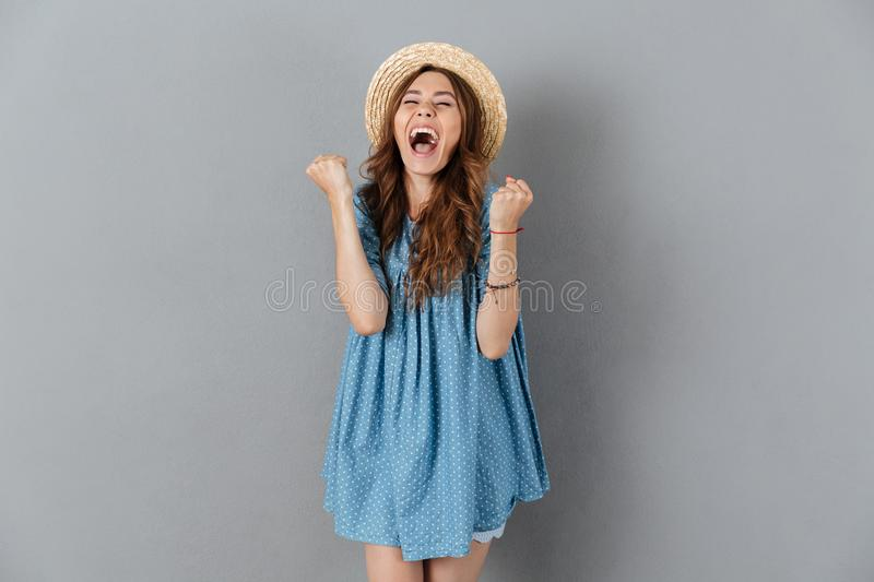 Pretty young caucasian lady showing winner gesture stock images