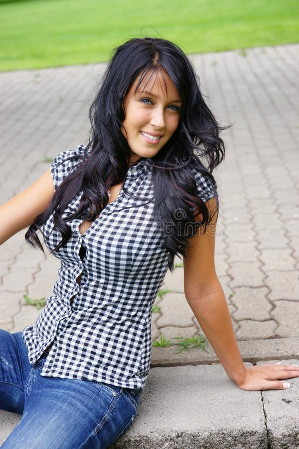 Picture of pretty young woman with long black hair stock image