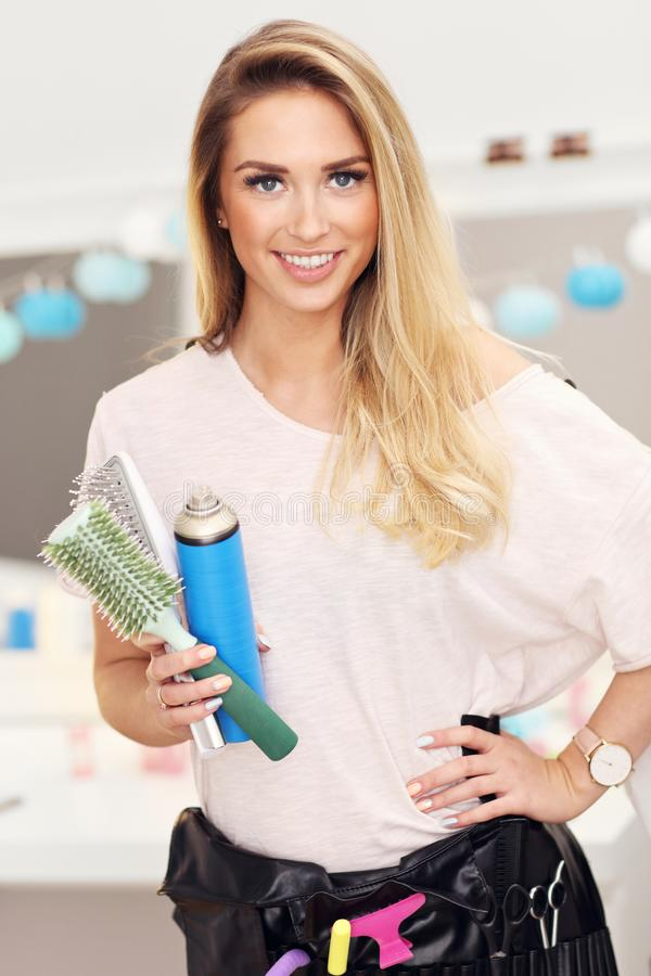 Professional hairdresser in her salon royalty free stock image