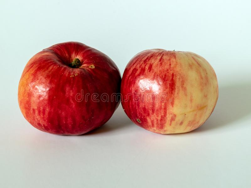 Picture with red apples on a light background. Simple picture with red apples on a light background stock image
