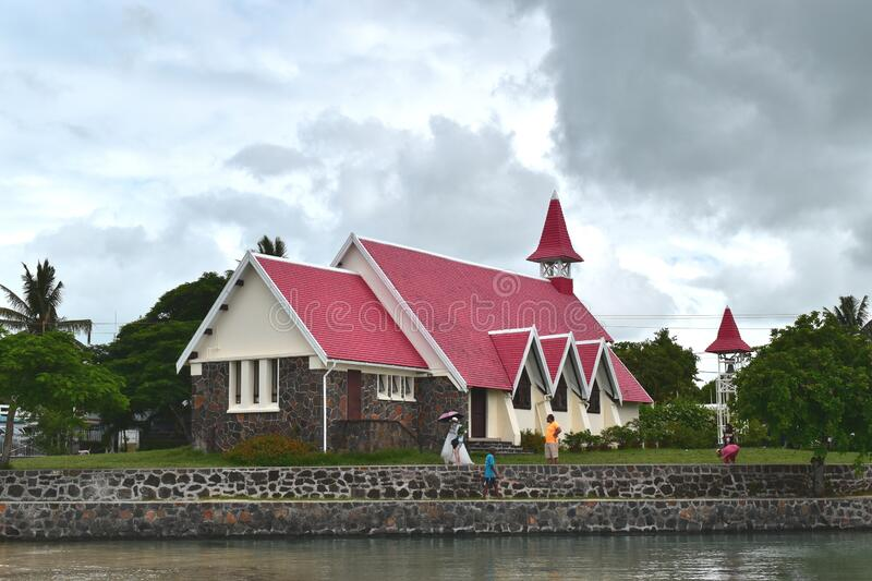 Picture of a red church located close to a beach, very famous touristic place within Mauritius Island. royalty free stock photo