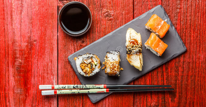Picture of rolls with chopsticks royalty free stock photo