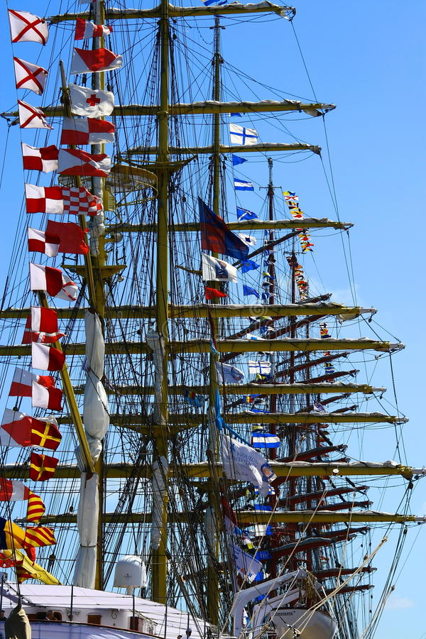 Picture of sailing boats with parade flags royalty free stock image