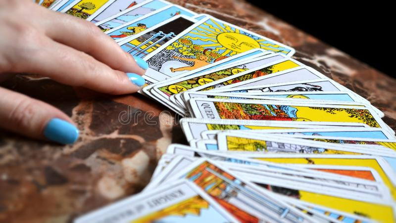 Tarot Reading Cards. In this picture we see a person who is performing a tarot reading with a Rider-Waite deck vector illustration