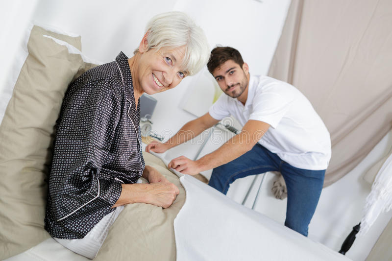 Picture senior woman and young man stock photography