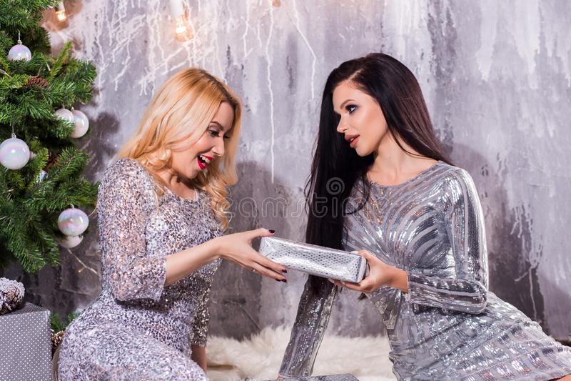 Picture showing best friends celebrating New Year. Surprise Christmas gift. New Year, holiday, celebration, winter concepts royalty free stock photography
