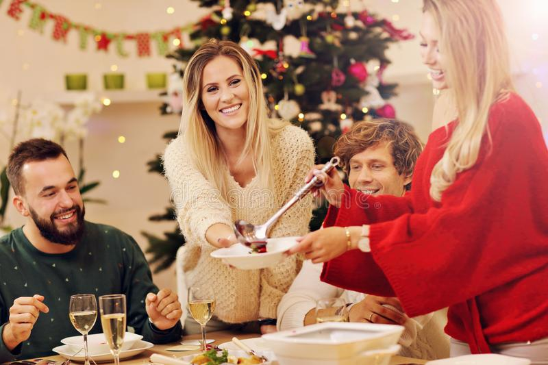 Group of family and friends celebrating Christmas dinner royalty free stock image
