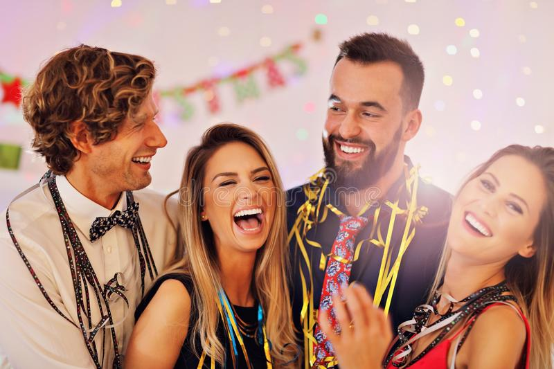 Picture showing group of friends having fun with at Party stock images