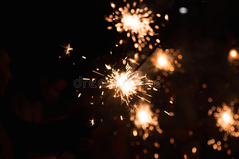 Picture showing group of friends having fun with sparklers royalty free stock image