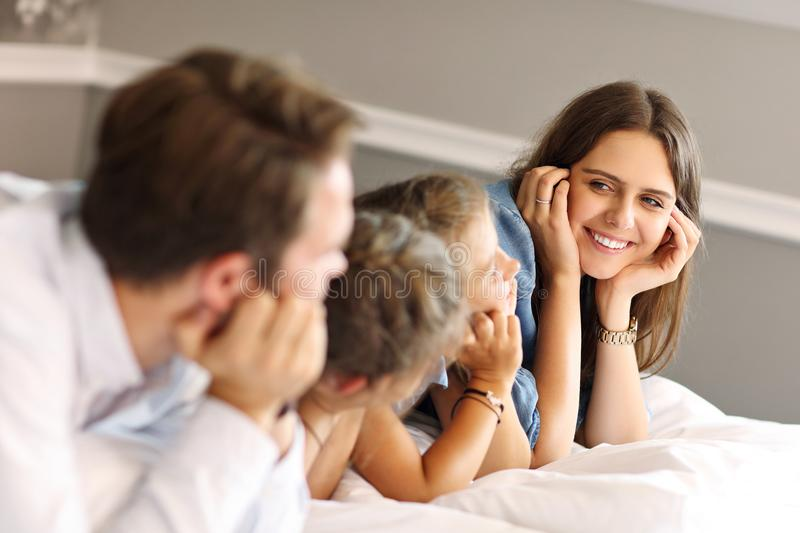 Happy family relaxing in hotel room stock photography