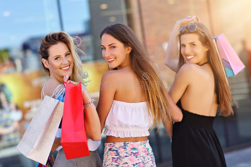 Happy girl friends shopping in mall royalty free stock images