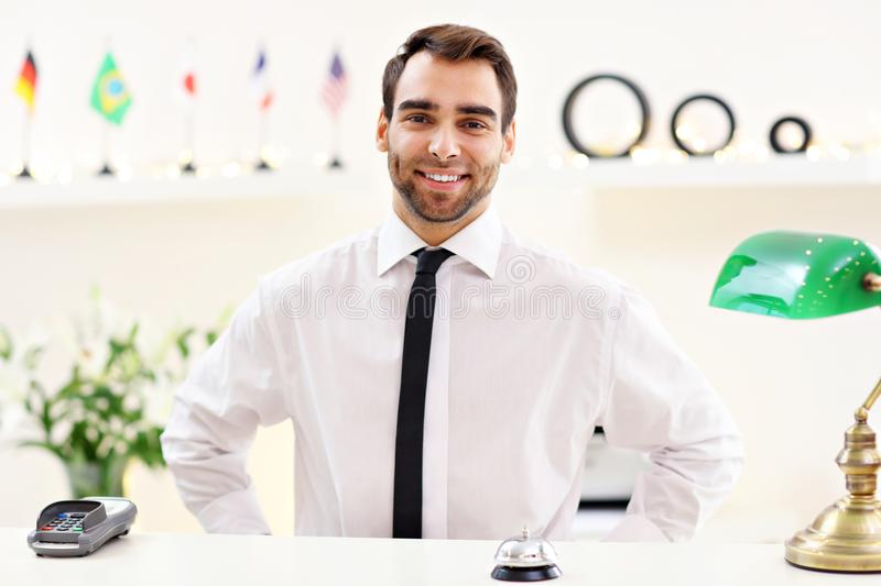 Happy receptionist working in hotel. Picture showing happy receptionist working in hotel stock images