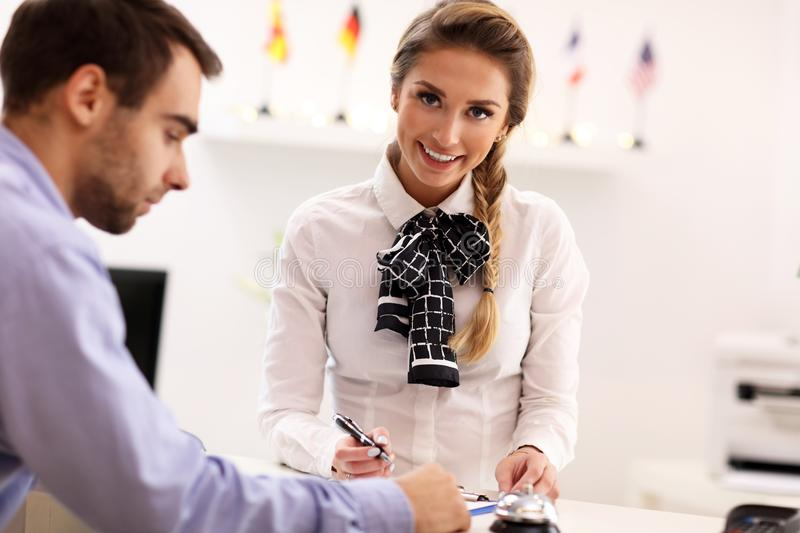 Hotel receptionist talking with guest. Picture showing receptionist talking with guest royalty free stock photo