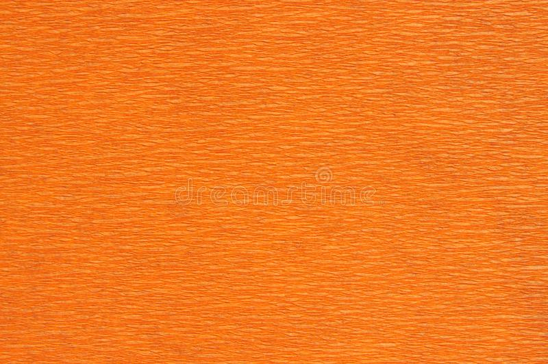 Background with orange crepe paper royalty free stock image