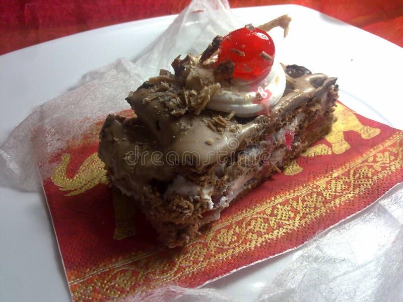 Shiny cherry on a chocolate slice... stock image