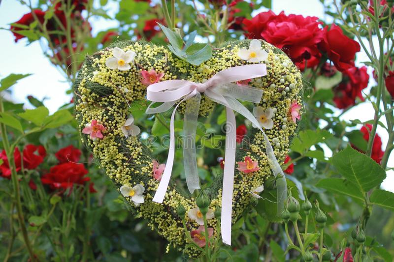 Romantic heart in red roses. The picture shows a romantic heart in red roses stock image