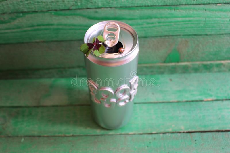 I wish you the best of luck !. The picture shows a silver can with a lucky clover and a ladybird stock photography