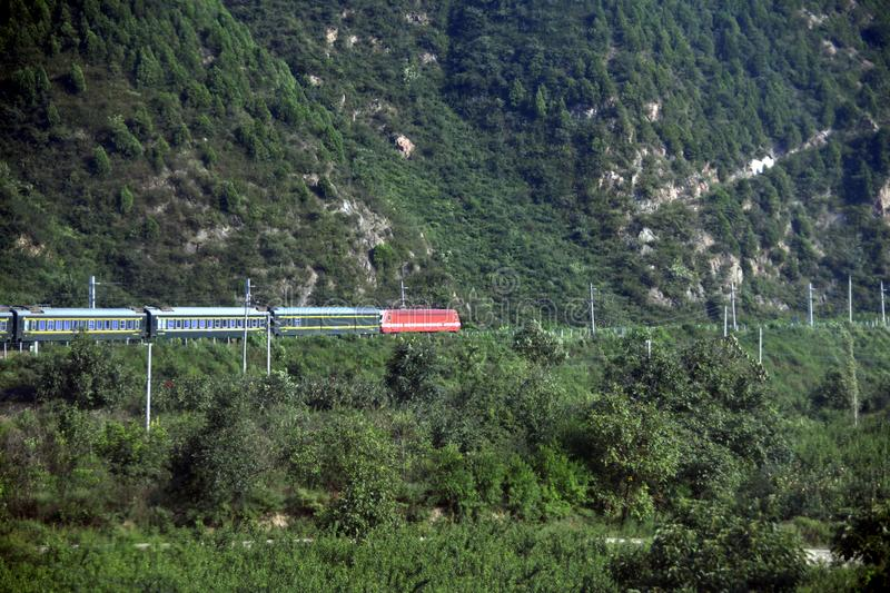 Qinling Mountains: scenery on the north south boundary of China. The picture shows a train travelling in Qinling Mountains in August 22, 2018. Ming Fan royalty free stock photo